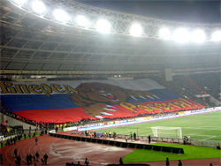 Russian fans release an massive 130 metre by 80 metre banner in the lead up to the Russia - England qualifying match for EURO 2008. The banner depicts a large roaring bear with the words 'Russia, forward!' Wikipedia:Roman Kovrigin
