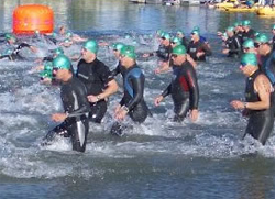Paul's miraculous healing from a back injury enabled him to enter triathlons. Photo: Ironman competitors enter the water. Wikipeida/Jkrabbe