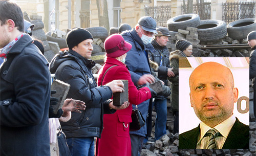 Ukrainian protestors building a barricade in Kiev. Insert Baptist Pastor Oleksadr Turchynov Wikipedia: