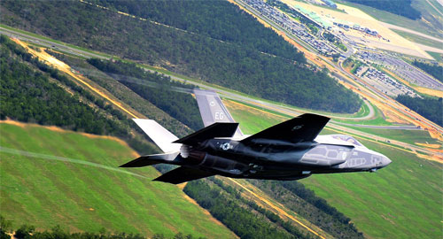 Two managers at Elgin Air Force base criticized for having Duck Dynasty decals on their vehicles. Photo F-35 arriving at Fort Elgin: Wikipedia/US Air Force