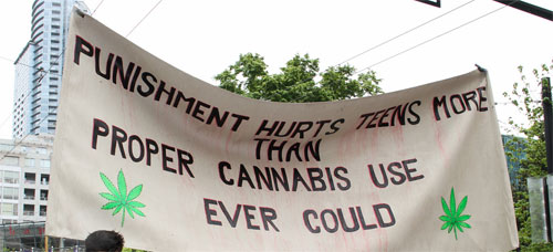 Sign at 2014 Vancouver rally calling for legalization of marijuana. Unfortunately, studies are revealing the very serious damage cannabis usage can cause to the brains of teens. Photo: Flickr | Cannabis Culture