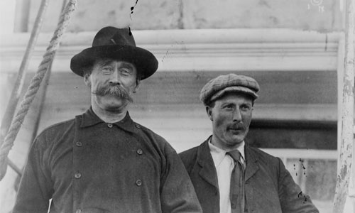 Robert Peary and Captain Robert Bartlett on their ship in Battle Harbour, Labrador, Canada in 1909