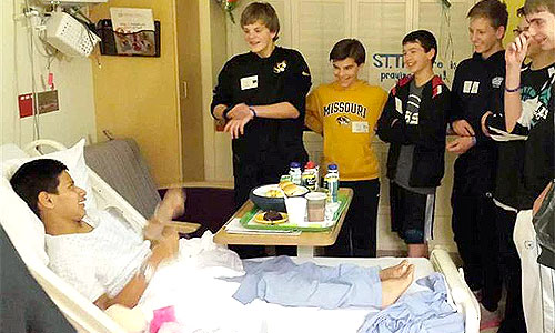 The miracle boy John Smith with friends. Photo: NBC News