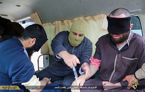 Islamic State terrorists pump stricken man with pain killers prior to amputation. Photo: Daily Mail