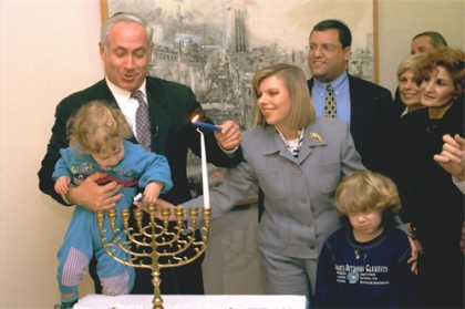 Israeli Prime Minister Benjamin Netanyahu lighting Hanuka candles with his wife and sons/Flickr/Government Press Office