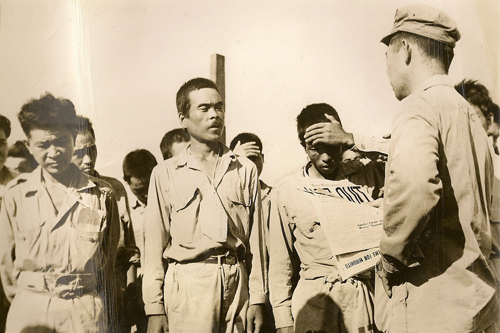Japanese POWs stunned by announcement of Japanese surrender during World War II