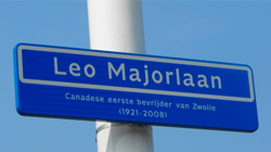 A street was name after Sergeant Major in the Village of Zwolle. The sign reads: Leo Major Lane Canadian First Liberator of Zwolle (1921-2008)