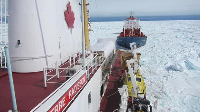Canadian Coast Guard Ice Breaker CCSG Pierre Radisson resucing a ship caught in the ice on the Hudson Bay on July 17, 2015. Source: dfo_central-twitter
