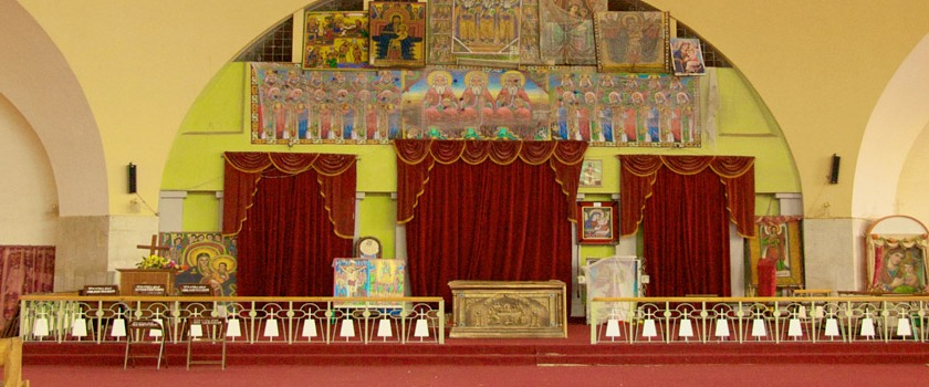 Inside St. Mary's Church of Zion in Axum, Ethiopia. The church claims to house the Jewish Ark of the Covenant, and some suggest it is behind the curtains. Photo: Flickr/A.Davey