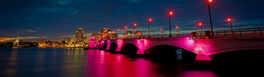 Pink lights flooding a bridge in West Palm Beach Florida during Breast Cancer Awareness week. Photo: Foter/captainkimo.com