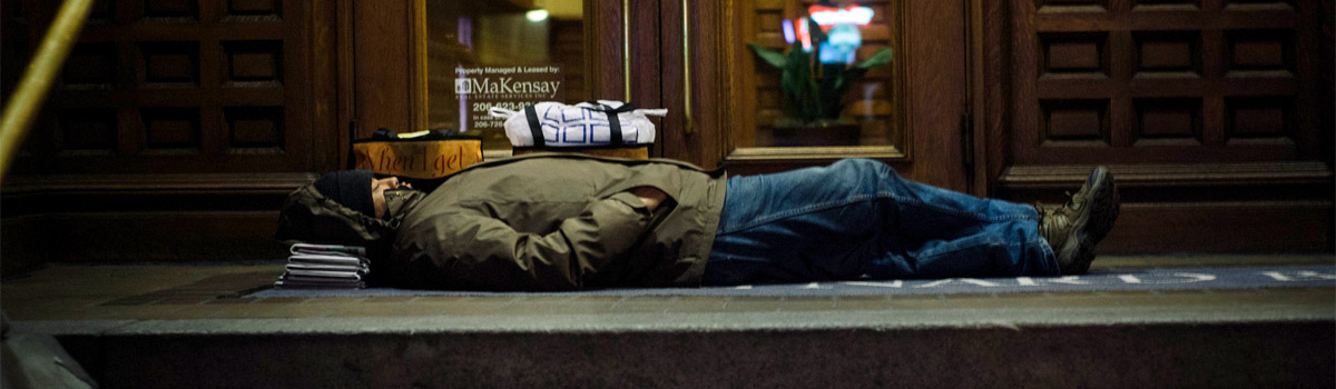 Sleeping on paper and pavement in 40 degrees. Photo Graf Spee/Foter/CC BY