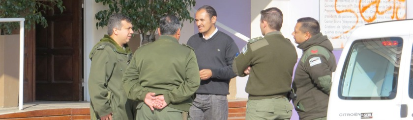 A member of the Pueblo Grande Baptist Church talks with members of Argentina's gendarmerie after the church was vandalized: Photo Morning Star News