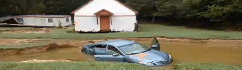 Clara Gantt's car in the front yard of the church after the flood Photo: Video Capture WIS TV