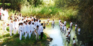 Iranians dressed in white waiting to be baptized. Photo: Elam Ministries