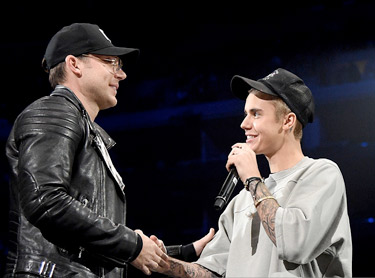 Justin Bieber with Judah Smith at LA concert.