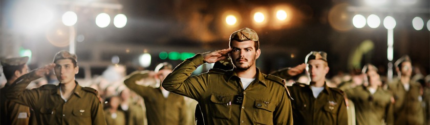 Israeli officers saluting their flag Photo: Israel Defense Forces/Flickr/Creative Commons
