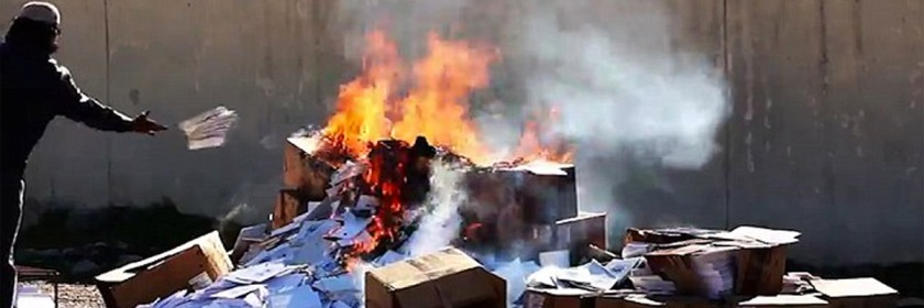 ISIS burning Bibles in Mosul.
