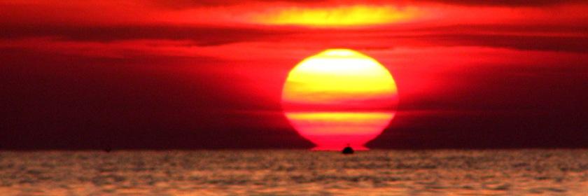 Ship sailing into the sunset. Photo: Ozgur Mulazimoglu/Flickr/Creative Commons