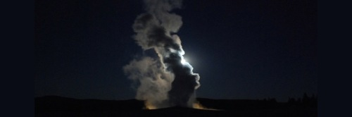 Full moon peering out behind exploding Old Faithful in Yellowstone Park Photo: Miles Ritter/Flickr/Creative Commons