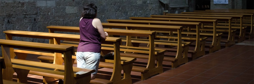 Praying in a cathedral in Tuscany, Italy. Photo: ashokboghani/Flickr/Creative Commons