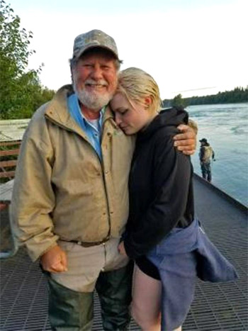 Pastor Andy Foor with the young woman he rescued on July 15, 2016 along the banks of Alaska's Kenai River.