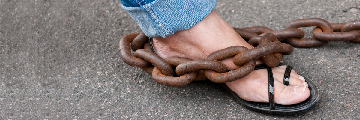 What chains your feet?