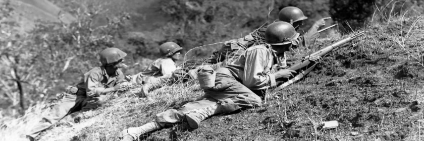American soldiers advancing on Japanese positions in World War 2.