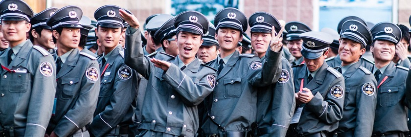 Chinese security guards (Baoan) hamming it up for a photographer. Credit: Ding Zhou/Fickr/Creative Commons