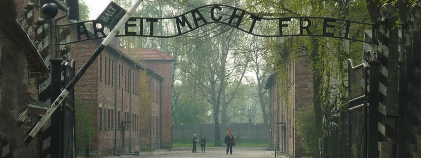 "Entrance to the Auschwitz Concentration Camp. The sign reads ""Work Sets You Free."" Credit: Igor Griffiths/Flickr/Creative Commons"