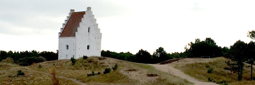 The Bell tower of the Sand covered church sticking out of the ground near Skagen, Denmark Credit: Myrna Petersen