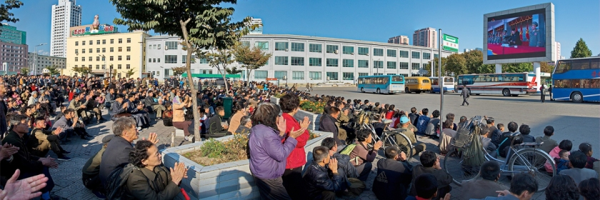 People in Pyongyang, North Korea watching Kim Jong-un on a TV broadcast in 2015. Credit: Uwe Brodrecht/Wikipedia