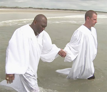 Pastor McKinnon about to baptize Parker in the Atlantic Ocean Credit: NBC screen capture