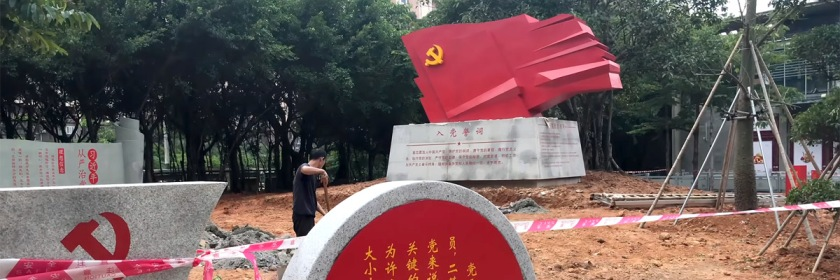 Monument displaying Communism's hammer and sickle being installed in a park in China: Credit: Serpentaz/Youtube capture