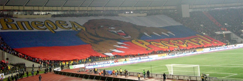 "Russian supporters unveiling massive banner portraying an dangerous bear and the words ""Russia Forward"" prior to Euro 2008 soccer match against England Credit: Roman Kovrigin/Wikipedia"